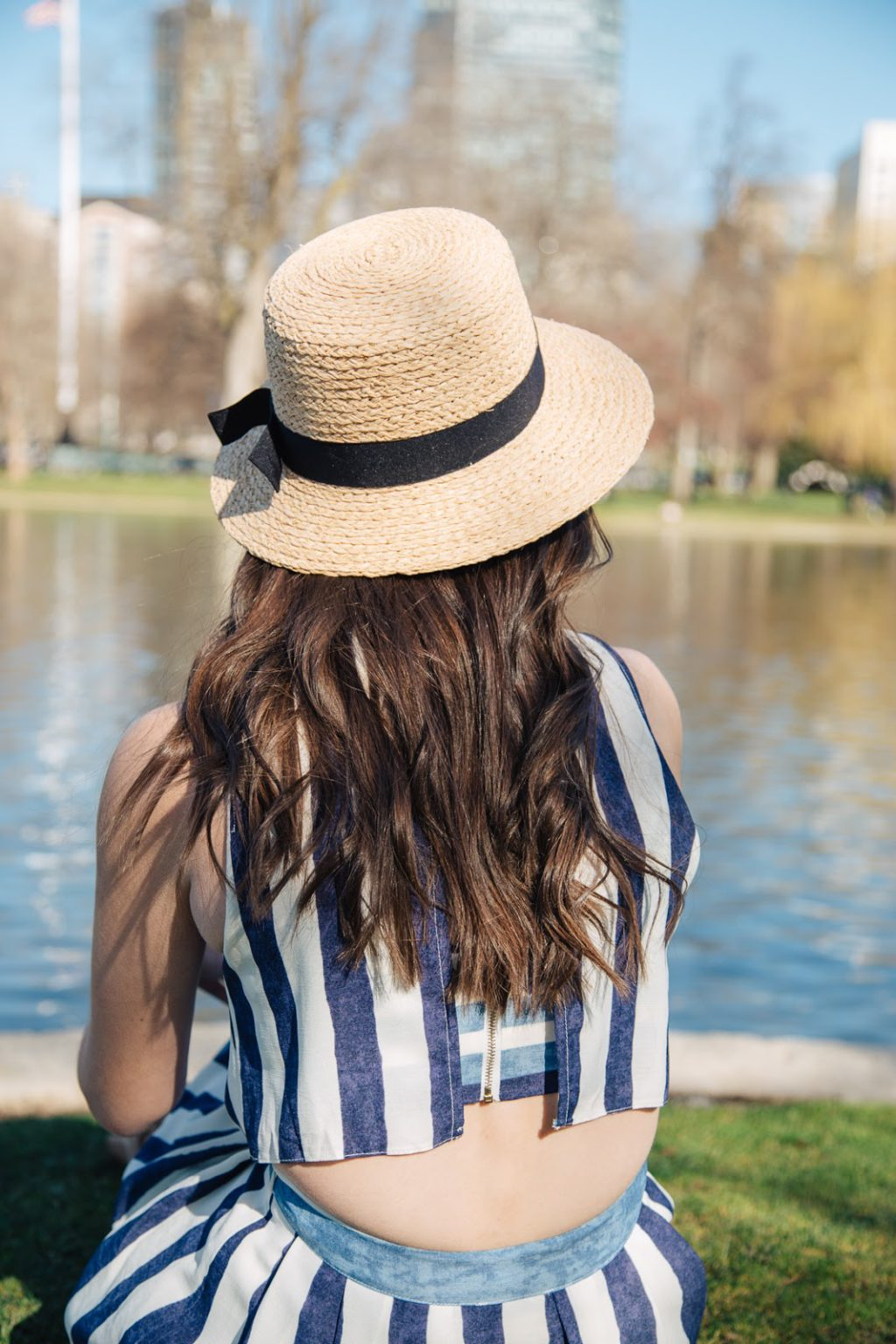 Pairing loose curls with a straw Sole Society boater for a cute and casual look.