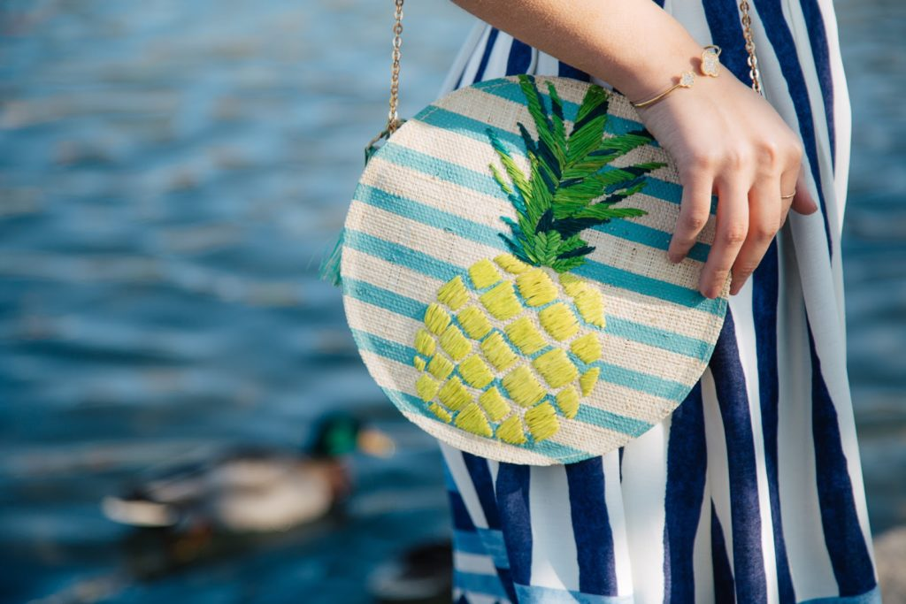 Adding a playful touch to this matching Everly set by pairing it with a pineapple bag from KAYU design