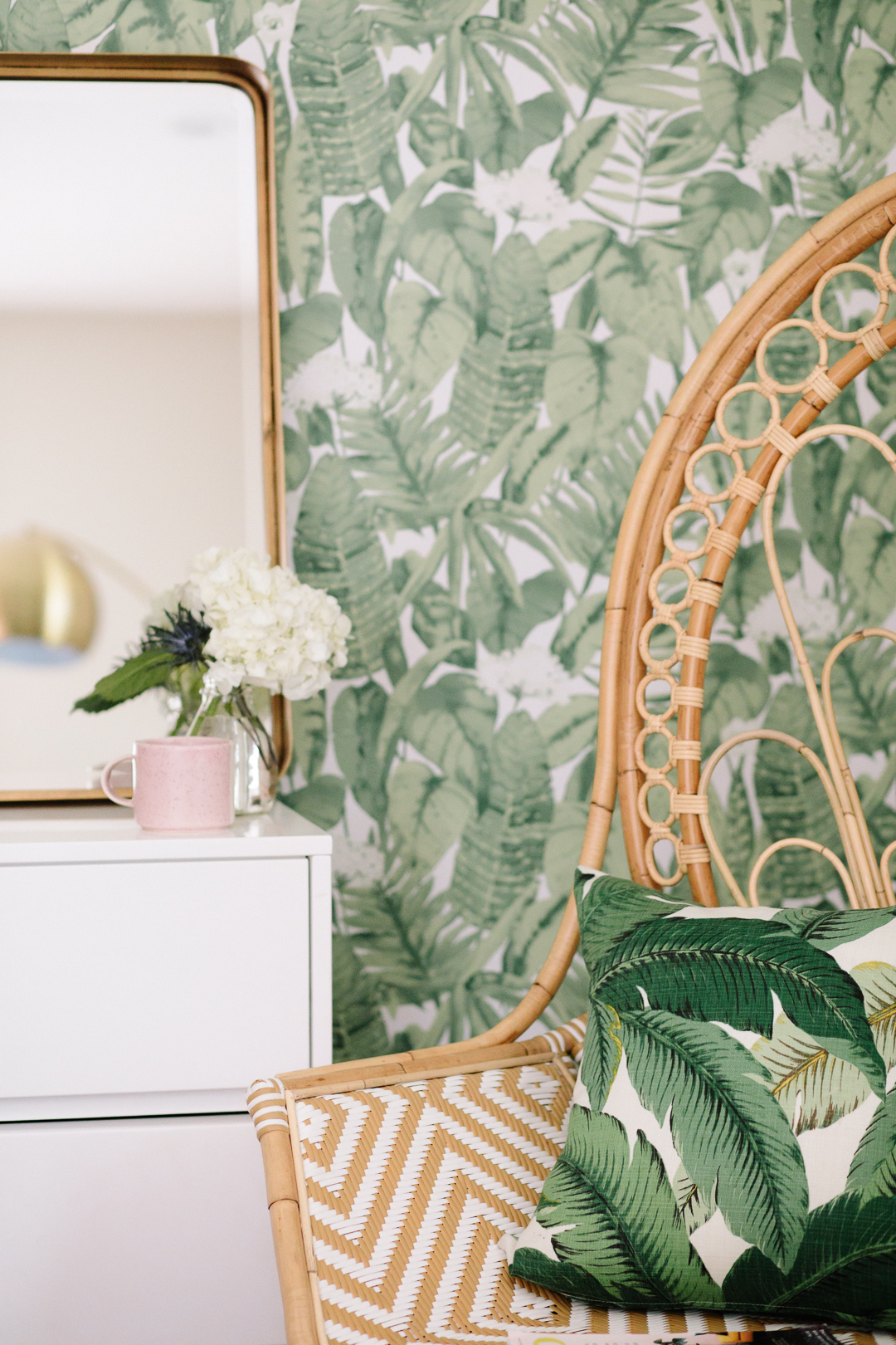 Justina Blakeney accent chair and banana leaf wallpaper